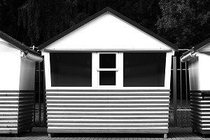 Horizontal black and white empty mini shop bokeh background