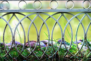 Curved park fence bokeh background