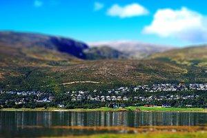 Fragment of outskirts of Tromso bokeh background
