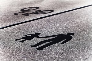 Diagonal pedestrian bicycle sign on road background