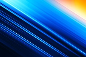 Diagonal blue motion blur ocean with sun background