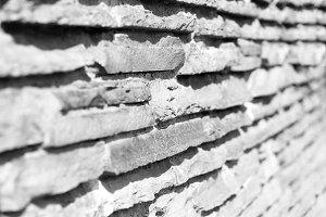 Diagonal black and white stone wall background