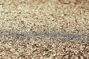 Horizontal brown ground texture with bokeh background