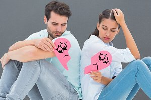 Composite image of sad couple sitting holding two halves of broken heart
