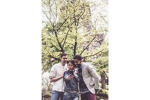 Multi-ethnic Group Of Friends Having Fun In Park Near Eiffel