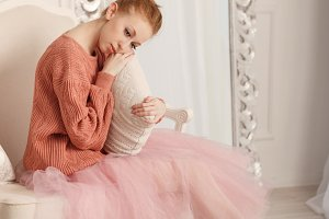Ballerina sad hugging pillow