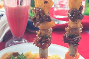 Close up shot of grilled kebab on a red background in restaurant. Tropical island of Bali, Indonesia.