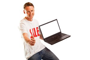 Young Man With 'sale' T-shirt And Laptop