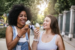 Friends eating one ice cream.
