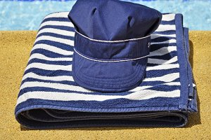fishing hat and striped towel