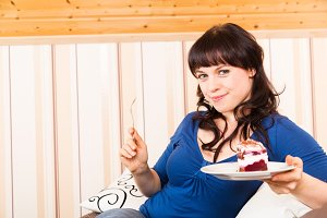 Young Woman Enjoying A Piece Of Cake