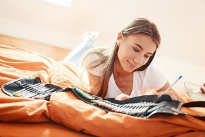 Young Woman On Bed, Drawing In Coloring Book