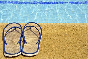 women's sandals on the pool