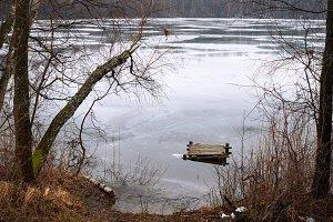 old wooden bridge on frozen lake