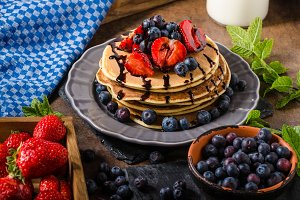 American pancakes with berries and chocolate