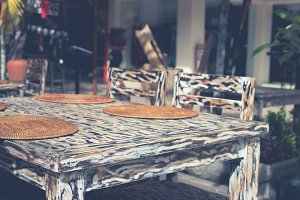 Beautiful wooden table colored in leopard style in street cafe. Bali island, Indonesia.