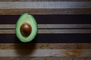 Avocado on wood cutting board