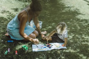 Beautiful mother with child draws