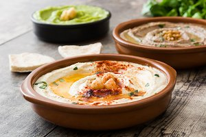 Different hummus bowls.
