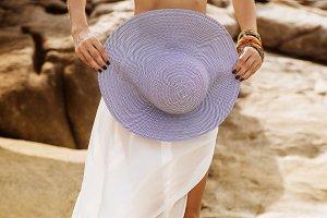 Beautiful girl posing with sun hat.