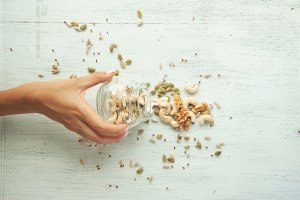 Seeds and nuts are scattering from the jar