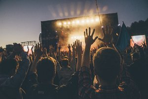 Crowd puts hands up at festival