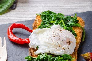 Toasted baguette with poached egg