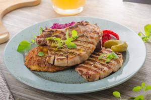 Grilled pork chops with herbs and garlic, potato pancakes
