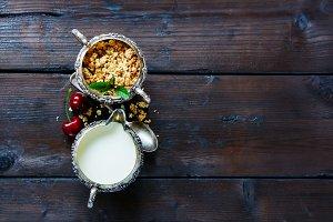 Granola, milk and cherry
