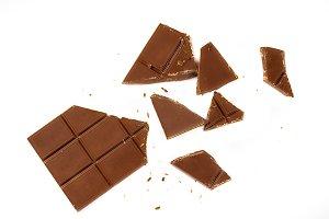Broken tiles of milk chocolate