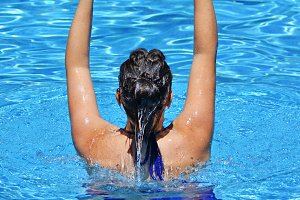 woman exercising in the pool