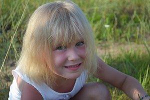 Cute little child girl in the meadow
