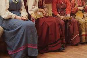 Russian folk musical group - girls in traditional costumes plays musical instruments