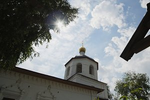 Wooden orthodox Cross and dome of church - slider shot