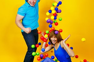 Young couple playing with balls