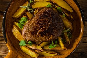 Beef steak with herbs and wine
