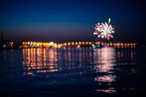 Blurred fireworks above sea