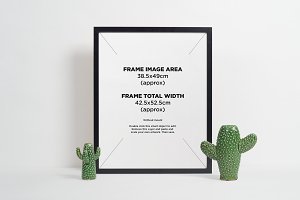 Black picture frame + ceramic vases