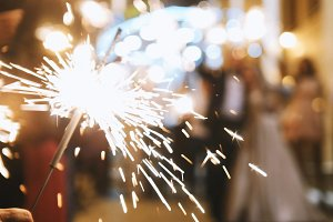 Fireworks in hands of guests - wedding evening