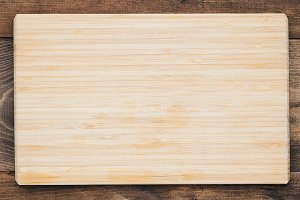 Top view of an empty wooden rectangular cutting board