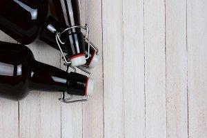 Swing Top Beer Bottles on Wood