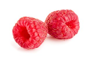 Two raspberries isolated on white background macro