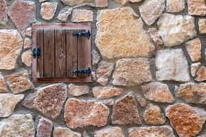 Old window on an stone wall