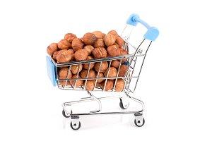 hazelnut in a shopping cart isolated on white background
