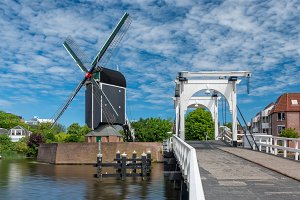 Bridge and windmill in Netherlands
