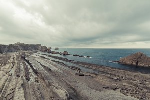 Rocky beach in a stormy day