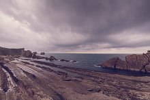 Rocky beach in a stormy day