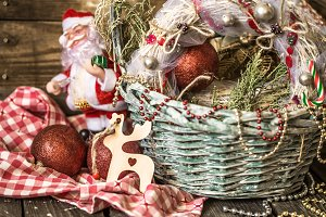 Christmas basket on wooden background