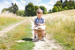 Beautiful little boy with book