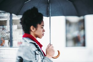 Black girl with umbrella